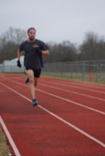 Darren running 100s. Sadly, my lens was blurry :(